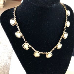 Jewelry - Pale yellow bead framed station gold tone necklace